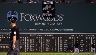 During Wednesday night's game between the Boston Red Sox and the Oakland A's, some fans unfurled a protest sign accusing the U.S. of being a racism-loving country.