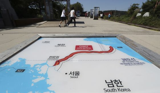 Visitors walk by the map of two Koreas at the Imjingak Pavilion in Paju, South Korea, Wednesday, Sept. 13, 2017. South Korea said Wednesday it conducted its first live-fire drill for an advanced air-launched cruise missile it says will strengthen its pre-emptive strike capability against North Korea in the event of crisis. (AP Photo/Lee Jin-man)