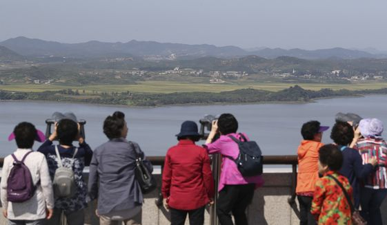 Visitors watch the North side from the unification observatory in Paju, South Korea, Wednesday, Sept. 13, 2017. South Korea said Wednesday it conducted its first live-fire drill for an advanced air-launched cruise missile it says will strengthen its pre-emptive strike capability against North Korea in the event of crisis. (AP Photo/Lee Jin-man)