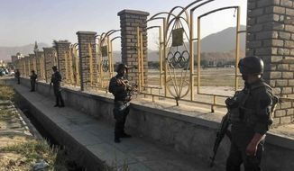 Afghan security police stand guard near the site of a deadly suicide attack outside a cricket stadium, in Kabul, Afghanistan, Wednesday, Sept. 13, 2017. (AP Photo/Rahmat Gul)