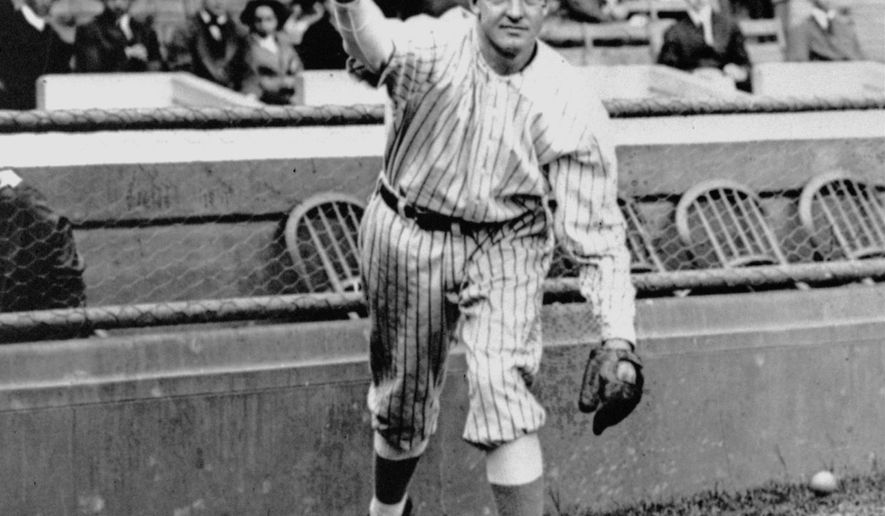 In this 1910 file photo,  New York Giants star pitcher Christy Mathewson, who won 373 games during his career which spanned 17 years, from 1900 to 1916. poses with a baseball. The New York Giants in 1916 were an extremely streaky team. They offset a 2-13 start with 17 consecutive wins on the road, then later set a major league record with 26 straight wins during a 31-game homestand at the Polo Grounds. (AP Photo/File)