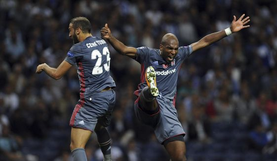 Besiktas' Ryan Babel, right, celebrates with teammate Cenk Tosun after scoring his side's third goal during the Champions League group G soccer match between FC Porto and Besiktas at the Dragao stadium in Porto, Portugal, Wednesday, Sept. 13, 2017. (AP Photo/Paulo Duarte)