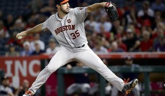 Houston Astros starting pitcher Justin Verlander throws to a Los Angeles Angels batter during the first inning of a baseball game in Anaheim, Calif., Tuesday, Sept. 12, 2017. (AP Photo/Chris Carlson)