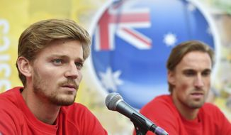 Belgium's David Goffin, left, speaks during a press conference prior to a Davis Cup World Group tennis semi-final in Brussels, Tuesday, Sept. 12, 2017. Belgium plays a semi-final against Australia beginning Friday, Sept. 15, 2017. (AP Photo/Geert Vanden Wijngaert)