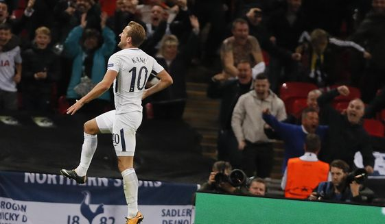Tottenham's Harry Kane celebrates after scoring his side third goal during the Champions League group H soccer match between Tottenham and Borussia Dortmund, at the Wembley stadium in London, Wednesday, Sept. 13, 2017. (AP Photo/Kirsty Wigglesworth)