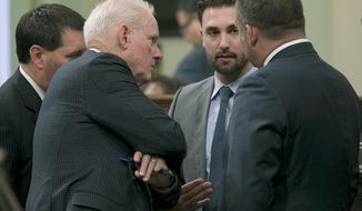 Democratic Assembly members, from left, Tim Grayson, of Concord, Tom Daly, of Anaheim, Ian Caldron, of Whittier, and Adam Gray of Merced, huddle during the Assembly session, Wednesday, Sept. 13, 2017, in Sacramento, Calif. Lawmakers are working to complete this years legislative business to meet the Friday, Sept. 15 deadline. (AP Photo/Rich Pedroncelli)