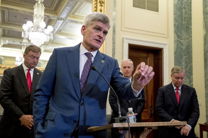 From left, Sen. Dean Heller, R-Nev., Sen. Bill Cassidy, R-La., Sen. Ron Johnson, R-Wis., and Sen. Lindsey Graham, R-S.C., hold a press conference on Capitol Hill in Washington, Wednesday, Sept. 13, 2017, to unveil legislation to reform health care. (AP Photo/Andrew Harnik)