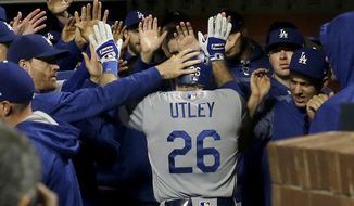 Los Angeles Dodgers' Chase Utley (26) is congratulated after hitting a solo home run against the San Francisco Giants during the fourth inning of a baseball game in San Francisco, Tuesday, Sept. 12, 2017. (AP Photo/Jeff Chiu)