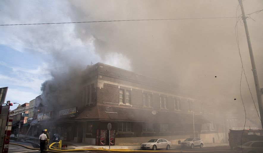 A fire in LaGrange, Ind., caused heavy smoke to envelope the downtown area in a fire at the Family Dollar Store that was a total loss Tuesday, Sept. 12, 2017. The downtown brick structure collapsed later in the day and neighboring businesses were damaged in the fire. (Patrick Redmond/The News Sun via AP)