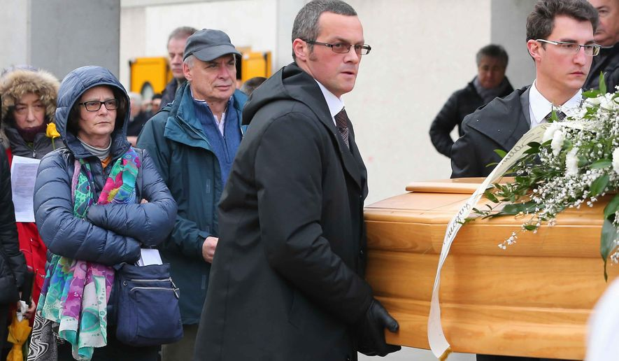 FILE -- In this Feb. 12, 2016 file photo, the family of Giulio Regeni follows his coffin during the funeral service in Fiumicello, Northern Italy. Egyptian prosecutors have ordered the detention for 15 days of a lawyer who assisted the family of an Italian graduate student killed under suspicious circumstances during a police crackdown in Cairo, accusing him of disseminating false news. Ibrahim Metwally was arrested at Cairo International Airport Sunday, Sept. 10, 2017, while traveling to Geneva for a U.N. meeting on enforced disappearances. (AP Photo/Paolo Giovannini, File)