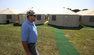 Farmers Village at Wake Nation co-mayor Jeff Losey is among the 75 employees who are staying at the village Tuesday, Sept. 12, 2017, in Rosharon, Texas. Renting the private space meant the company would not be using hotel rooms within the Houston area. ( Godofredo A. Vasquez/Houston Chronicle via AP)