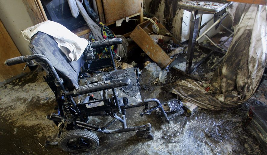 FILE - In this Sept. 16, 2005, file photo, a wheelchair with a slipper still on the footrest sits in the mud left behind by Hurricane Katrina at St. Rita's Nursing home, where 34 people died while waiting to be rescued from the floodwaters in St. Bernard, La. Regulations dictate nursing homes and other facilities must have preparation plans in place for hurricanes, floods, tornadoes and other natural disasters, but the realities of how older Americans cope with a storm go beyond any piece of paper. The issue burst to the forefront again Wednesday, Sept. 12, 2017, with news of several deaths at the Rehabilitation Center at Hollywood Hills in Florida, where workers say Hurricane Irene caused the air conditioning to fail, and they struggled to keep residents cool with fans, cold towels and ice.  (AP Photo/Anja Niedringhaus, File)