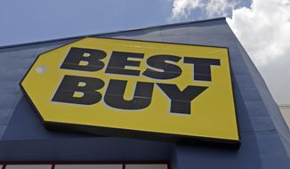 FILE - This Monday, May 22, 2017, file photo shows a Best Buy sign at a store in Hialeah, Fla. Best Buy said it will no longer sell software made by the Russian company Kaspersky Labs. (AP Photo/Alan Diaz, File)