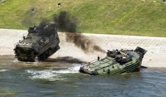 This Sept. 6, 2016, photo released by the U.S. Marine Corps shows Marines with the 2nd Amphibious Assault Battalion aboard AAV-7 Amphibious Assault vehicles during an exercise on the Cumberland River in Nashville, Tenn. The Marine Corps said Wednesday, Sept. 13, 2017 that an AAV-7 similar to these one caught fire during a training exercise at Camp Pendleton, Calif., and 15 Marines were taken to area hospitals, including several with serious injuries. (Lance Cpl. Jered Stone/U.S. Marine Corps via AP)