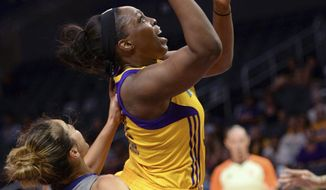 Los Angeles Sparks guard Chelsea Gray (12) drives to the basket and is fouled by Phoenix Mercury's Leilani Mitchell (5) during the first half of a WNBA basketball playoff game Tuesday, Sept. 12, 2017, in Los Angeles. (Stephen Carr/Los Angeles Daily News via AP)