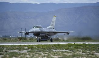 This photo taken Aug. 17, 2017 and provided by the U.S. Air Force, shows an F-16 Fighting Falcon ready for take-off in preparation to perform a final joint flying mission at Holloman Air Force Base in Alamogordo, N.M.  Holloman Air Force Base officials say their current array of flight training areas in southern New Mexico is outdated and that some need to be expanded, reshaped and relocated. (Stacy Jonsgaard/U.S. Air Force via AP)