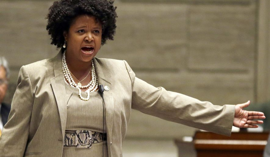 FILE - In this Sept. 10, 2014, file photo, Missouri state Sen. Maria Chappelle-Nadal speaks on the Senate floor in Jefferson City, Mo. Missouri state senators have voted to formally discipline the colleague who posted on social media that she hoped for President Donald Trump's assassination. Chappelle-Nadal removed the comment from her Facebook page the same day she posted it last month and apologized. She has said the remark was made in frustration over Trump's response to a violent white nationalist rally in Virginia. (AP Photo/Jeff Roberson, File)