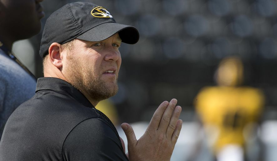 FILE - In this Sept. 2, 2017, file photo, Missouri head coach Barry Odom watches his team warm up before the start of an NCAA college football game against Missouri State, in Columbia, Mo. Missouri fired former defensive coordinator DeMontie Cross after its loss the South Carolina last week, the second straight game in whcih the Tigers' defense had struggled. Coach Barry Odom is hoping for quick improvement on that side of the ball when Missouri hosts Purdue on Saturday. (AP Photo/L.G. Patterson, File)