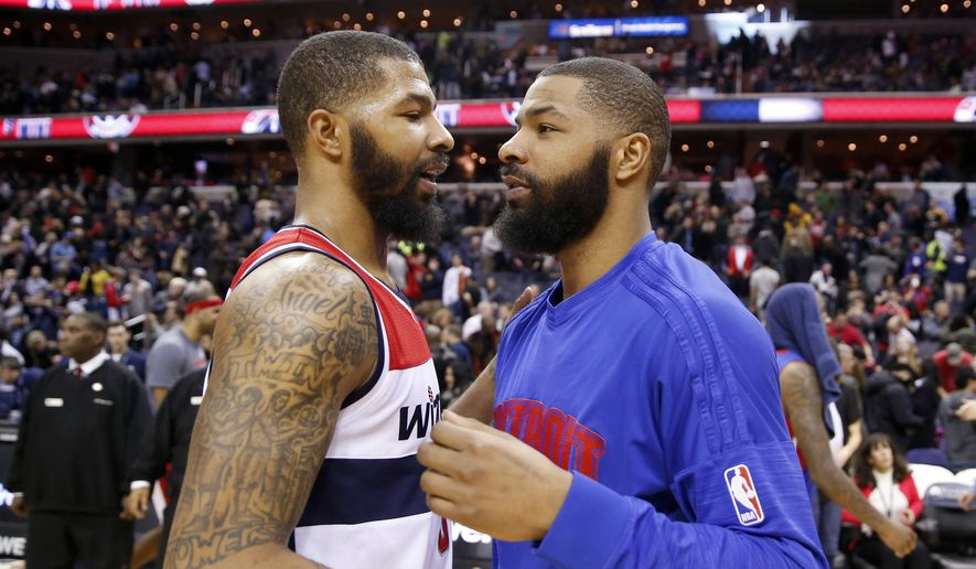 FILE - In this Feb. 19, 2016, file photo, Washington Wizards forward Markieff Morris, left, and Detroit Pistons forward Marcus Morris talk on the court after an NBA basketball game in Washington. A trial will begin for NBA players Marcus and Markieff Morris, who allegedly assaulted a man outside a Phoenix recreation center two years ago. Maricopa County Superior Court officials announced the trial's upcoming jury selection will start Wednesday morning, Sept. 13, 2017. (AP Photo/Alex Brandon, File) **FILE**