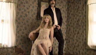"This cover image released by Red House Records shows ""Contraband Love,"" a release by Larry Campbell and Teresa Williams. (Red House Records via AP)"
