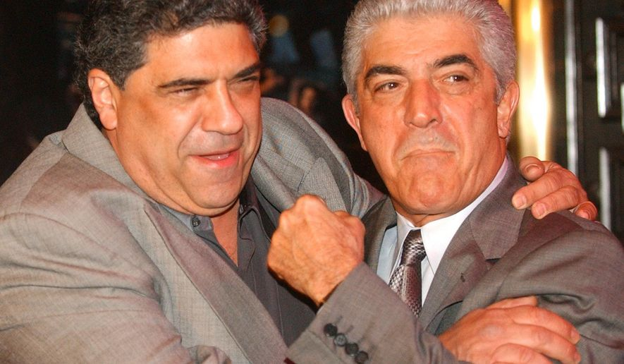 """FILE - In this March 2, 2004 file photo, actors Vincent Pastore, left, and Frank Vincent rough around for photographers at the fifth season premiere of the HBO series """"The Sopranos,"""" at New York's Radio City Music Hall. Vincent, a veteran character actor who often played tough guys including mob boss Phil Leotardo on """"The Sopranos,"""" has died. He was 80. (AP Photo/Frank Franklin II, File)"""