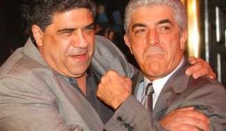 "FILE - In this March 2, 2004 file photo, actors Vincent Pastore, left, and Frank Vincent rough around for photographers at the fifth season premiere of the HBO series ""The Sopranos,"" at New York's Radio City Music Hall. Vincent, a veteran character actor who often played tough guys including mob boss Phil Leotardo on ""The Sopranos,"" has died. He was 80. (AP Photo/Frank Franklin II, File)"