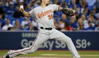 Baltimore Orioles starting pitcher Kevin Gausman (39) works against the Toronto Blue Jays during the first inning of a baseball game, Wednesday, Sept. 13, 2017 in Toronto. (Nathan Denette/The Canadian Press via AP)
