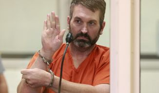 Anthony Pisano, a suspect in a triple homicide at a precious metals and coin shop, appears at his arraignment at the Anchorage jail on Wednesday, Sept. 13, 2017, in Anchorage, Alaska. Pisano is charged with three counts of first-degree murder. (AP Photo/Dan Joling)