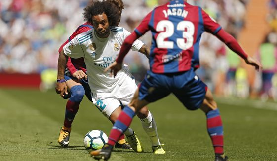 """Real Madrid's Marcelo, left, battles for the ball with Levante's David Remeseiro """"Jason"""" during the Spanish La Liga soccer match between Real Madrid and Levante at the Santiago Bernabeu stadium in Madrid, Saturday, Sept. 9, 2017. Marcelo was shown a red card and the match ended in a 1-1 draw. (AP Photo/Francisco Seco)"""