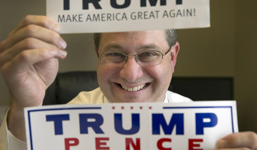 In this Jan. 11, 2017 photo, Trey Trainor, an Austin attorney specializing in election law who played a critical role for the Trump campaign at the Republican convention, poses with Trump campaign stickers at the Akerman Law Firm in Austin, Texas. The White House announced on Tuesday, Sept. 13, 2017, that President Donald Trump has appointed Trainor to the Federal Election Commission. (Ralph Barrera/Austin American-Statesman via AP)