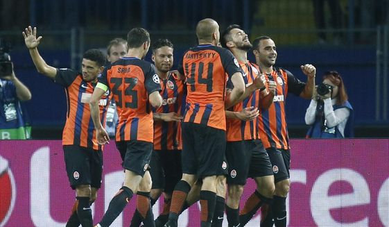 Shakhtar's Facundo Ferreyra, second from right, celebrates with his teamates after scoring his side's second goal during the Group F Champions League soccer match between Shakhtar Donetsk and Napoli at the Metalist Stadium in Kharkiv, Ukraine, Wednesday, Sept. 13, 2017. (AP Photo/Efrem Lukatsky)