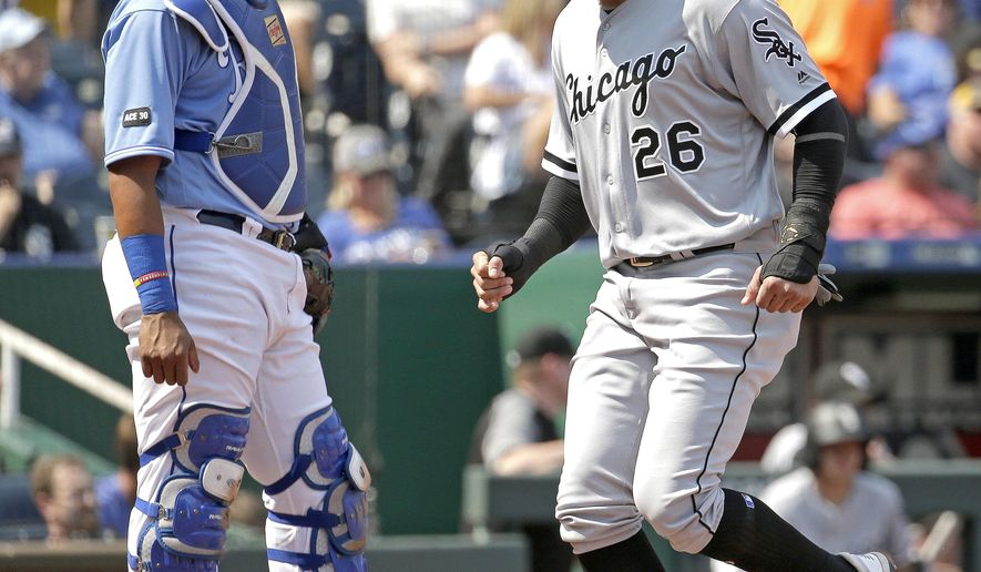 Chicago White Sox's Avisail Garcia (26) runs past Kansas City Royals catcher Salvador Perez to score on a single by Tyler Saladino during the third inning of a baseball game Wednesday, Sept. 13, 2017, in Kansas City, Mo. (AP Photo/Charlie Riedel)
