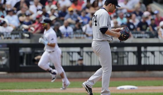 New York Yankees starting pitcher Jaime Garcia, right, reacts as Tampa Bay Rays' Kevin Kiermaier runs the bases after hitting a home run during the third inning of a baseball game Wednesday, Sept. 13, 2017, in New York. (AP Photo/Frank Franklin II)