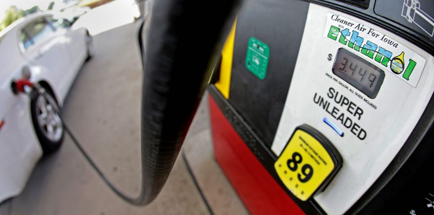 In this July 26, 2013, file photo, a motorist fills up with gasoline containing ethanol in Des Moines. (AP Photo/Charlie Riedel, File)