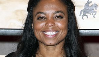 """Jemele Hill attending ESPN: The Party 2017 in Houston, Texas. ESPN says it has accepted the apology of its """"Sportscenter"""" host Jemele Hill for tweeting earlier this week that President Donald Trump was a """"white supremacist"""" and """"bigot."""" (Photo by John Salangsang/Invision/AP, File)"""