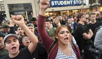 Protesters shout before a speaking engagement by Ben Shapiro on the campus of the University of California Berkeley in Berkeley, Calif., Thursday, Sept. 14, 2017. Several streets around the University of California, Berkeley, were closed off Thursday with concrete and plastic barriers ahead of an evening appearance by the conservative commentator  the latest polarizing event to raise concerns of violence on the famously liberal campus.(AP Photo/Josh Edelson)