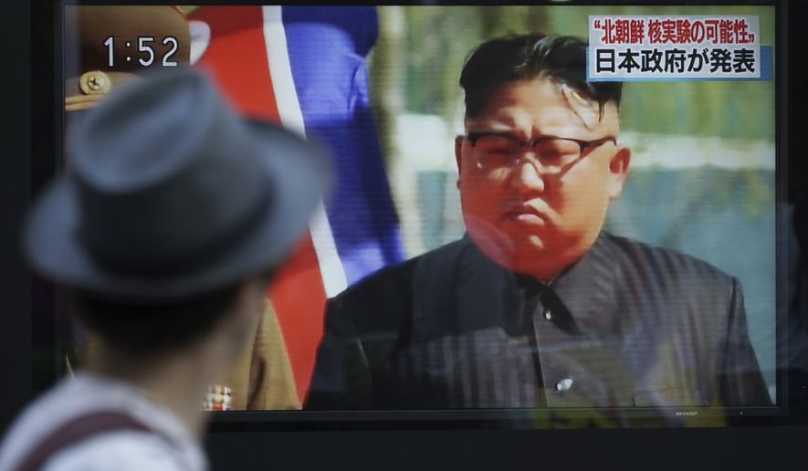 A man watches a TV news program on a public screen showing an image of North Korean leader Kim Jong Un while reporting North Korea's possible nuclear test in Tokyo. The top commander of U.S. nuclear forces says he assumes the Sept. 3 nuclear test by North Korea was a hydrogen bomb. Air Force Gen. John E. Hyton, commander of Strategic Command, told reporters that while he was not in position to confirm it, he assumes from the size of the underground explosion and other factors that it was a hydrogen bomb, which is a leap beyond the fission, or atomic, bombs North Korea has previously tested.(AP Photo/Eugene Hoshiko)
