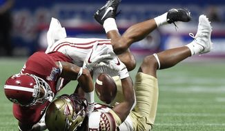 FILE - In this Sept. 2, 2017, file photo, Florida State wide receiver Nyqwan Murray (8) misses the catch as Alabama's Anthony Averett (28) defends during the first half of an NCAA football game, Saturday, Sept. 2, 2017, in Atlanta. For all the talk of Alabama's five-star recruits, some unsung guys like converted receiver Anthony Averett and former walk-ons Levi Wallace and Jamey Mosley are also playing key roles. (AP Photo/Mike Stewart, File)