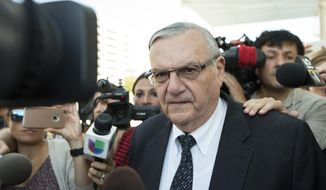 In this July 6, 2017, file photo, former Sheriff Joe Arpaio leaves the federal courthouse in Phoenix, Ariz. (AP Photo/Angie Wang, File)