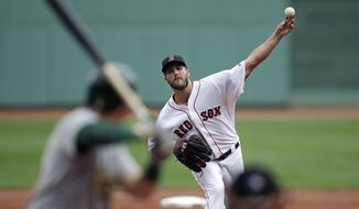 Boston Red Sox starting pitcher Drew Pomeranz delivers during the first inning of a baseball game against the Oakland Athletics at Fenway Park in Boston, Thursday, Sept. 14, 2017. (AP Photo/Charles Krupa)