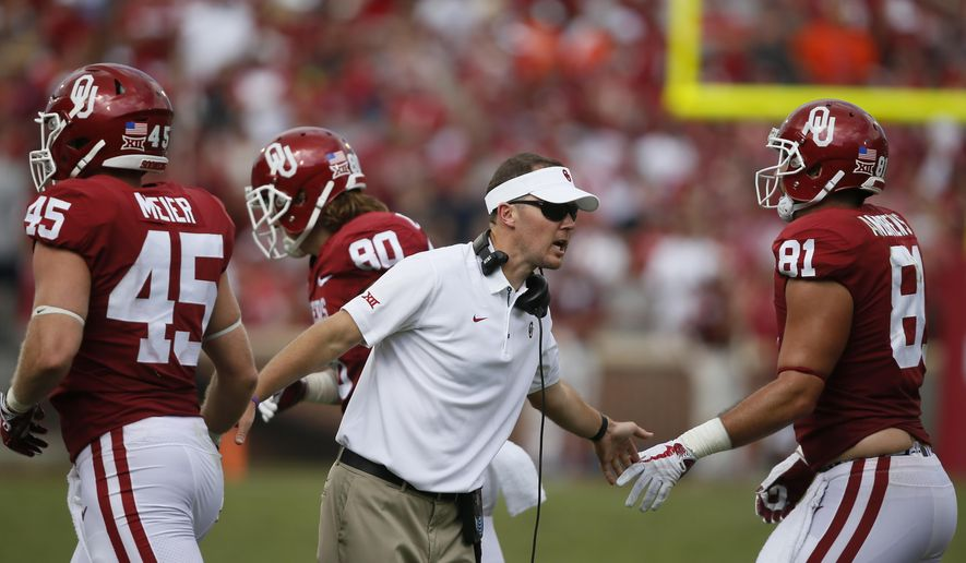 FILE - In this Sept. 2, 2017, file photo, Oklahoma head coach Lincoln Riley, center, greets players Carson Meier (45), Grant Calcaterra (80) and Mark Andrews (81) after a touchdown against UTEP in the second quarter of an NCAA college football game in Norman, Okla. Riley suddenly was leading the 10-time league champ with a Heisman Trophy-caliber quarterback, Tom Herman took over a Texas program with plenty of ups and downs since being the league's last national champ 12 seasons ago, and Matt Rhule never expected his job at Baylor to be easy. The results so far clearly reflect the situations inherited by the Big 12's three new head coaches. (AP Photo/Sue Ogrocki, File)