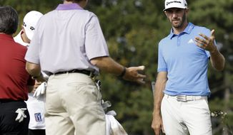 Dustin Johnson, right, talks with his team members on the 12th hole during the pro-am of the BMW Championship golf tournament at Conway Farms Golf Club, Wednesday, Sept. 13, 2017, in Lake Forest, Ill. (AP Photo/Nam Y. Huh)