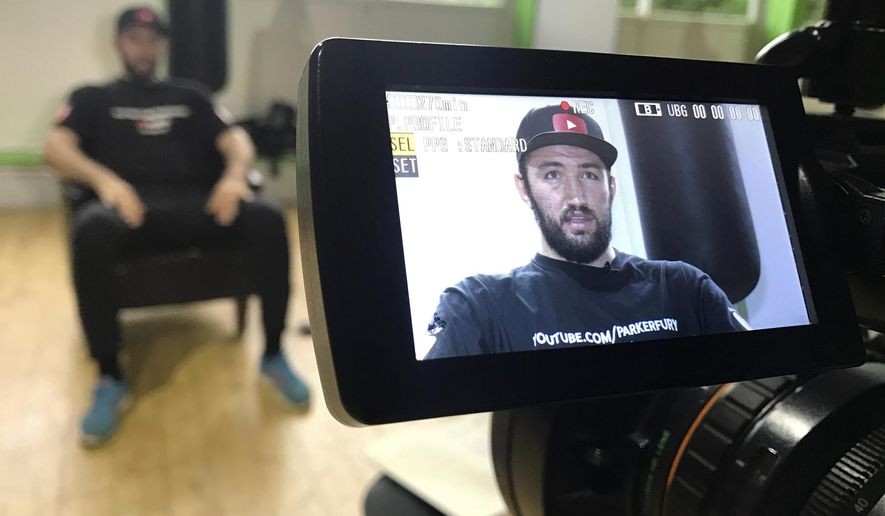 In this picture taken Thursday, Sept. 7, 2017, British boxer Hughie Fury, who is fighting for the world heavyweight title, speaks during an interview with the AP at a gym in Windermere, northern England. He is only 22, yet he feels it is his destiny to complete his rise to the top of the sport by beating WBO champion Joseph Parker of New Zealand in Manchester on Sept. 23. (AP Photo/Davidde Corran)