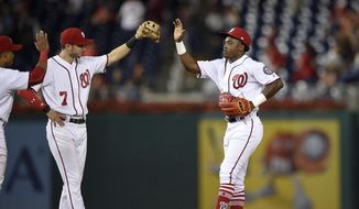 Washington Nationals' Victor Robles, right, celebrates with Trea Turner (7) after a baseball game against the Atlanta Braves, Thursday, Sept. 14, 2017, in Washington. The Nationals won 5-2. (AP Photo/Nick Wass) **FILE**