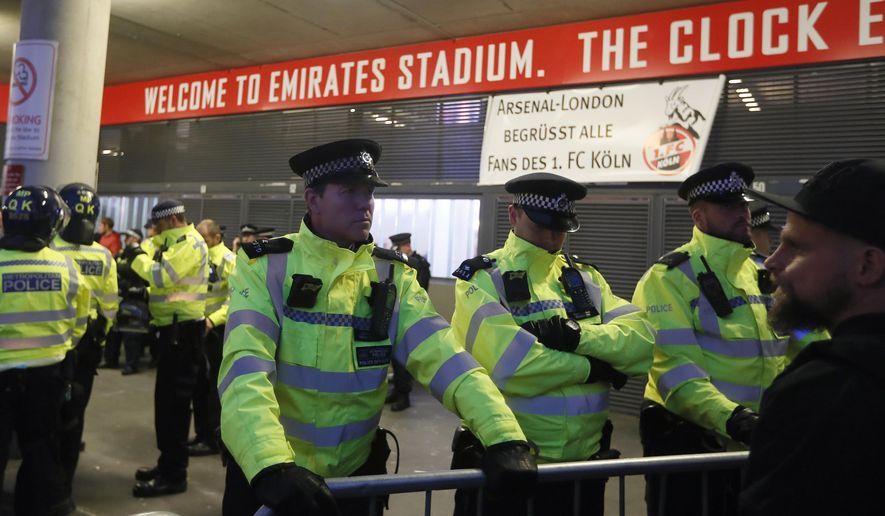 Police forces guard the entrance of the Emirates stadium prior to the Europa League group H soccer match between Arsenal and FC Cologne at the Emirates stadium in London, England, Thursday, Sept. 14, 2017 . (AP Photo/Kirsty Wigglesworth)