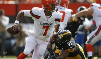 FILE - In this Sept. 10, 2017, file photo, Cleveland Browns quarterback DeShone Kizer (7) avoids Pittsburgh Steelers defensive end Stephon Tuitt (91) during the first half of an NFL football game in Cleveland. Kizer on Sunday, Sept. 17, will face the Baltimore Ravens, whose renowned defense opened the season by forcing five turnovers in a 20-0 rout of Cincinnati. (AP Photo/Ron Schwane, File)
