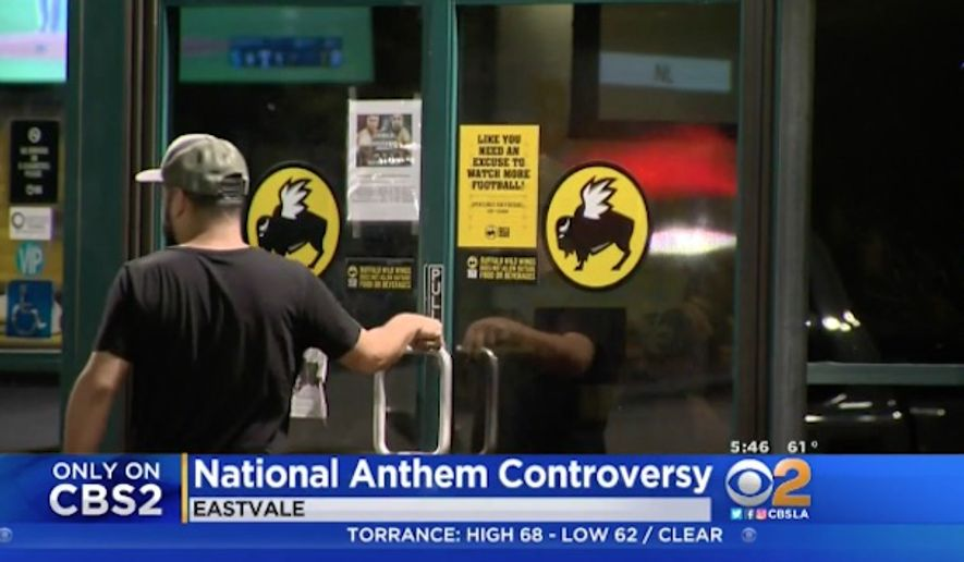 A Buffalo Wild Wings franchise in Eastvale, California, has apologized after customers said an employee censored the national anthem during a football game on 9/11. (CBSLA)