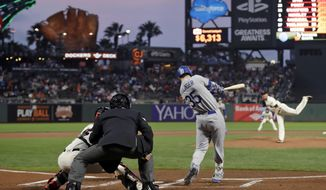 Los Angeles Dodgers' Cody Bellinger (35) drives in a run with a triple against the San Francisco Giants during the first inning of a baseball game Wednesday, Sept. 13, 2017, in San Francisco. (AP Photo/Marcio Jose Sanchez)