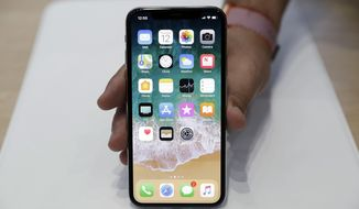 FILE - In this Tuesday, Sept. 12, 2017, file photo, the new iPhone X is displayed in the showroom after the new product announcement at the Steve Jobs Theater on the new Apple campus in Cupertino, Calif. Apple fans who froze their credit after the Equifax data breach may end up with another hassle on their hands if they try to get one of the new iPhones that can cost more than $1,000. People who did so and want to make any big purchase may find the same. (AP Photo/Marcio Jose Sanchez, File)