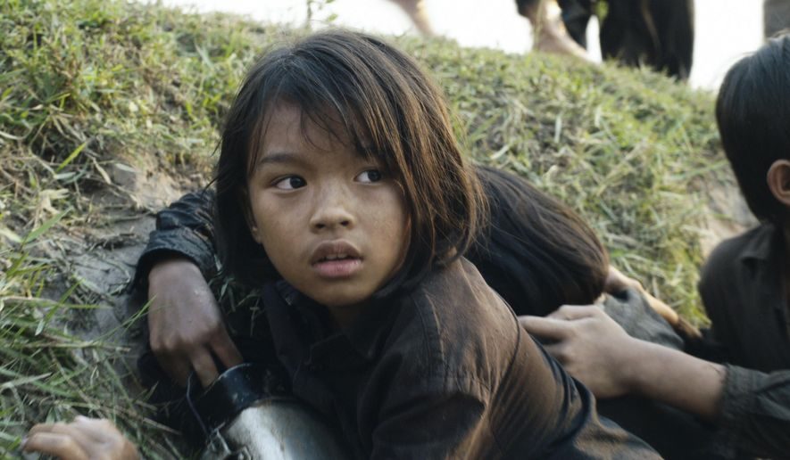 "This image released by Netflix shows Sareum Srey Moch  in a scene from ""First They Killed My Father: A Daughter of Cambodia Remembers."" (Netflix via AP)"